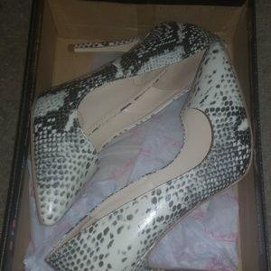 Gently worn beige snake skin heels